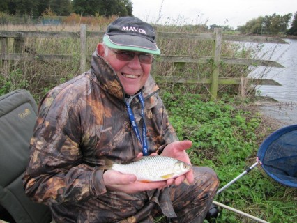 Geoff with his first fish a quality roach