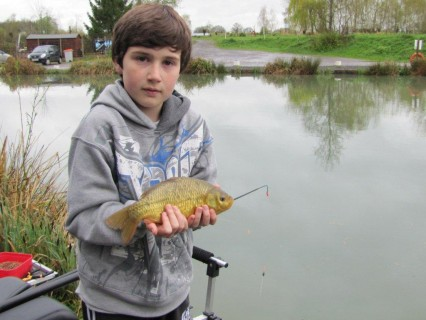 Cai with his first fish a crucian carp