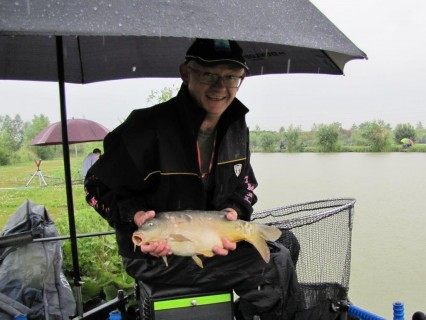 the rain did not stop the carp feeding