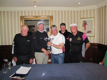 Paul Lees collecting the winners Trophy from match organiser John Hayes