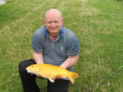 Paul with a beautiful golden 6lb koy carp
